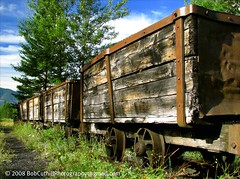 Coal Train From Yesterday (westrock-bob) Tags: wood old railroad blue trees summer sky copyright horse holiday canada tree green texture abandoned rock train canon ties photography town photo rust iron paint track image pics decay transport picture bob railway pic tourist cargo resort passengers explore photograph alberta transportation worn rails destination banff weathered coal 2008 gauge freight allrightsreserved westrock ironhorse ballast kanada kanata touristdestination resorttown holidaydestination cuthill s5is canons5is westrockbob bobcuthillphotographygmailcom bobcuthill