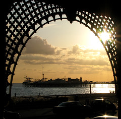 Underneath the Arches (monkeymillions) Tags: sunset shadow silhouette clouds pier brighton arches lightanddark