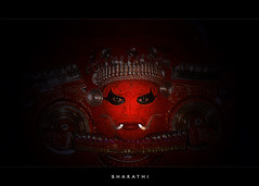 The truth lies behind the mask (bharathiclick) Tags: lighting red black eye yellow nice shot mask very good awesome bad dramatic kerala lovely abigfave bharathiclick