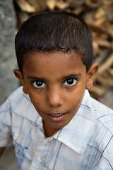 A boy with dark eyes - Al-Mukalla (Maciej 'Magic' Stangreciak) Tags: boy portrait children kid eyes magic middleeast arab lad yemen muslims maciej middleeastern arabs yemeni almukalla mukalla 40d mrmagic maciejstangreciak stangreciak aboywithbigeyes pbasecommagic maciejmagicstangreciak maciejmagic