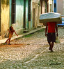 the little girl and the mattress (gianluca_cozzolino) Tags: world colour 35mm reflex nikon emotion havana cuba dia trinidad habana emotions nikonfm2 diapositiva reportage lahabana twr analogic diapo gianluca cozzolino abigfave nikonblack flickrlovers nikonflickrawardgold gianlucacozzolino nikonanalogic