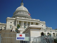 u.s. capital building from the front, fenced off with a sign that reads no access
