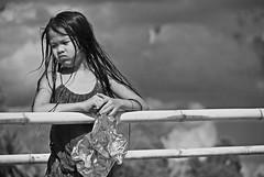 Sadness...... (Monia Sbreni) Tags: portrait blackandwhite bw blancoynegro asian blackwhite asia child noiretblanc zwartwit bn laos schwarzweiss ritratto pretoebranco lao bianconero luangprabang biancoenero blanconegro bambina emozioni svartvitt blackandwithe nikond80 bnritratto moniasbreni espressionidellanima