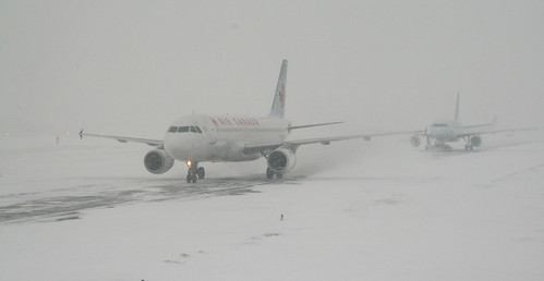 Airplanes Skidding In A Snow Storm