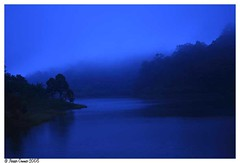 a misty evening... (Naseer Ommer) Tags: blue trees india mist water canon shadows kerala southindia canon1855mm naseerommer canoneos40d discoverplanet dpintl
