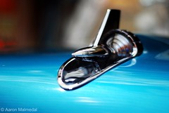 The Rocket (They Call Me Aaron!) Tags: blue painterly blur reflection classic belair car reflections 50mm nikon dof shine bokeh background air aaron depthoffield hood rocket distance belaire d60 diamondclassphotographer flickrdiamond