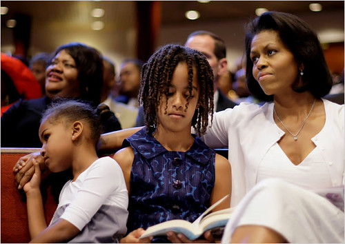 Michelle Obama, with her children, Sasha, 7, and Malia, 9, listened to her