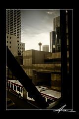 Dark City (jcruzfoto.com) Tags: city building bus calgary tower car skyline skyscraper dark downtown cab taxi 15 walkway transit catwalk calgarytower taxicab pedway calgarytransit grouptripod