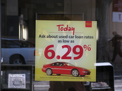 A sign at a car dealer advertising low interest rates