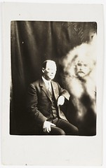 Man with a spirit face appearing (National Media Museum) Tags: portrait man sepia pose doubleexposure ghost backdrop paranormal occult seated espectro fantasma hombre espirito hoax marido spiritualist spiritphotograph nationalmediamuseum