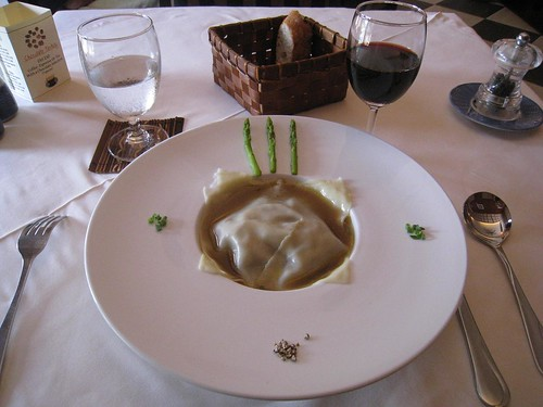 Foie gras ravioli in duck consomme with cabbage