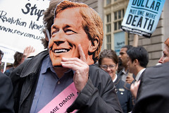 Jamie Dimon Mask at Bailout Protest (Lindsay Beyerstein) Tags: newyork color costume bush funny peace mask action outdoor manhattan protest peaceful bank bull demonstration wallstreet financial codepink economy liberal crisis mortgage jpmorgan dimon bailout agitpop subprime jamesdimon jamiedimon 700billion