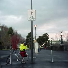 The Human Sign (Matt_Lew) Tags: man film bike sign zeiss fuji australia federationsquare melbourne victoria hasselblad human carl pro f28 planar 80mm 500cm hasselblad500cm 800z carlzeissplanar80mmf28 fujifilmpro800z