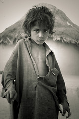Tharri Local Boy (Iqbal.Khatri) Tags: travel pakistan boy portrait bw dog water canon magazine eyes travels education truth village child desert mud traditional faith poor expressions culture hut blogged ng karachi sindh slum thar millionaire digg 400d iqbalkhatri slumdog mudmadehouses