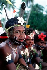 50007089 (wolfgangkaehler) Tags: boy portrait island tropicalisland papuanewguinea traditionalcostume villagepeople oceania villagelife villagescene villageboy traditionalclothing paintedface trobriand kiriwina nativeboy trobriandislands islandscene coastalvillage kiriwinaisland tropicalislandscene trobriandislandspng
