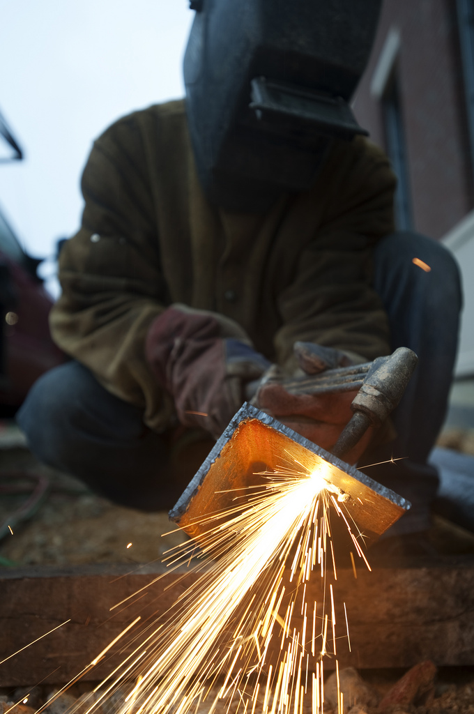 Iron worker cuts steel for installation in the roof of the U.S. Army Legal Services Agency (USALSA) headquarters