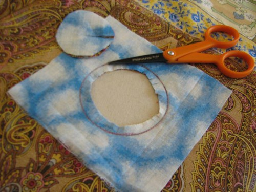 sew around circle on line. Trim center out and then cut tiny slashes around seam allowance