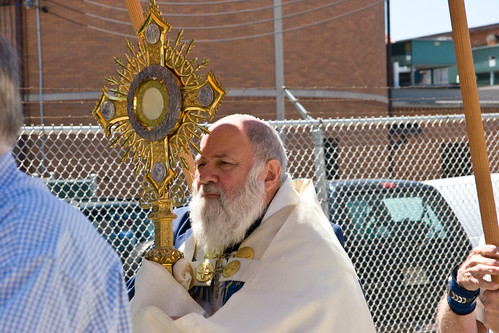 Fr. Paschal Morlinio, OSB Carrying Monstrance with Eucharist by Siena Photo.