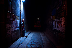 Night (TGKW) Tags: city light portrait people urban man night dark alley glasgow spotlight lane posters nightlife cobbles rik
