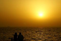 Persian Gulf and Couple (eshare) Tags: sunset sea sky sun beach silhouette landscape boat persian couple iran persia kish iranian  iranians persiangulf persians ruleofthirds    kishisland        takenfrombehind  sonyalphadslra100 sal50f14   100   sonyalpha50mmf14lens 5014