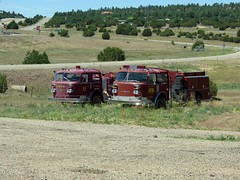 Old American La France Pumpers sitting out in front of the Sheridan Volunteer Fire Dept., New Mexico (Vladimir-911) Tags: rescue newmexico station truck fire lasvegas antique volunteers engine pump american vehicle historical nm emergency sheridan department appliance services apparatus vfd dept lafrance fd pumper