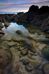 Crystal Clear (Nick Carver Photography) Tags: ocean california ca travel winter sunset sea usa cloud beach nature water rock vertical clouds landscape outdoors coast landscapes us rocks pacific nick boulders carver southerncalifornia orangecounty tidepools tidepool lagunabeach nickcarver ncpfineartprint