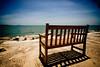 Waiting here (kktp_) Tags: ocean shadow sea sky beach bench thailand sand nikon pattaya d80 tokinaatx124afprodx1224mmf4