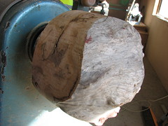 a wood burl, made cylindrical and ready for lathing