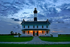 (Chuck Robinson) Tags: lighthouse sunrise sony northcarolina outerbanks a100 carlzeiss bodieisland nothdr cz1680 digitallyblended