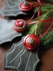 holly trio (lilfishstudios) Tags: red green recycled handmade holly ornaments etsy brass vintagebuttons lilfishstudios reclaimedleather