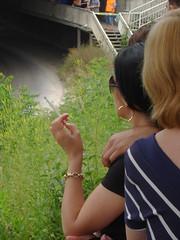 DSC01129 (pmp463) Tags: woman face hair glasses hand cigarette smoke earring bracelet brunette shoulder halfface