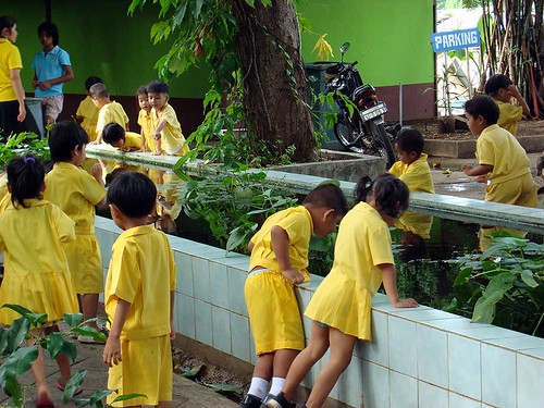 A school outing near the Bridge over the River Kwai. Monday royal yellow happily worn in pre-PAD days