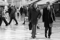 Business Man in galleria (.and+) Tags: street people bw italy white black businessman italia milano persone uomo movimento duomo galleria biancoenero emanuele vittorio uomini canonef50mmf14usm milanopeople