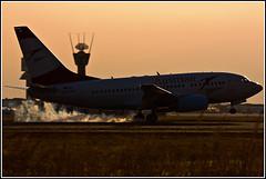737 Austrian Backlit (DavideITA) Tags: sunset canon airport dusk aircraft backlit boeing touchdown spotting 737 austrian mxp malpensa 100400 limc