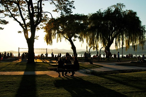 long shadows of Summer Solstice at Kits Beach, Vancouver