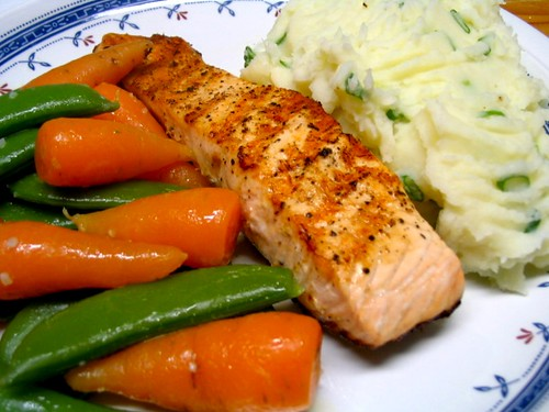 Grilled salmon with spring onion mash and vegetables in garlic butter