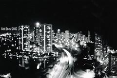 Gold Coast 2006 ([ Kane ]) Tags: longexposure blackandwhite motion blur art film gold coast australia motionblur scanned qld nightphoto kane goldcoast gledhill kanegledhill vivitarv2000 humanhabits wwwhumanhabitscomau kanegledhillphotography