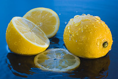 If life throws you a lemon - make lemonade. (Bald Monk) Tags: blue food robert water yellow fruit silver photography drops lemon photographer bald monk competition rob sharp lemons octopus splash liquids tunstall splashes bhcc strobist