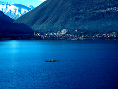 Italy, Lago Maggiore, Canoe (esinuhe69) Tags: blue panorama mountain lake snow mountains montagne sunrise landscape lago major alba blu canoe neve maggiore montagna canoa goldenglobe blueribbonwinner singintheblues frhwofavs excapture internationalgeographic flickrestrellas quarzoespecial esinuhe69