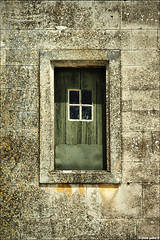 small window framed in a stone wall (julioc.) Tags: wood old windows portugal window beautiful stone wall architecture ventana geometry decay quality textures janela coimbra decayed e510 bigmomma ancientarchitecture julioc challengeyouwinner photographybyjulioctheblog olympuse510 a3b ilustrarportugal srieouro ilustrarportugal200806coimbra j2549