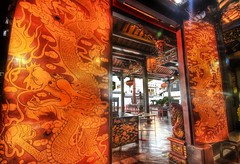 The Dragon Gate in Malacca (Stuck in Customs) Tags: old trip travel red wallpaper panorama orange sun streets lines yellow clouds asian photography nikon gate asia shoot photographer dragon shot angle image photos antique details famous rich d2x perspective picture dragons edge malaysia temples pro antiques portfolio capture stores hdr melaka curios malaka curio stuckincustoms treyratcliff