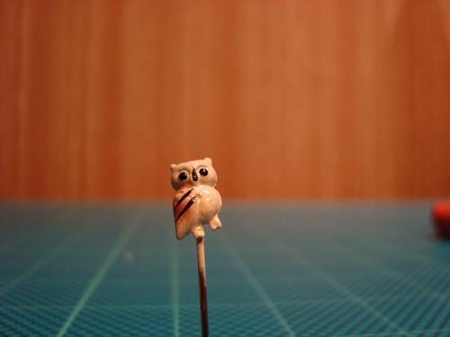 An owl pin