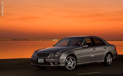 E55 AMG (Mishari Al-Reshaid Photography) Tags: auto street longexposure light sunset sea reflection cars 2004 water car monster photoshop canon silver reflections lights mercedes benz seaside automobile power flash german mercedesbenz kuwait canoneos photoshopcs2 v8 automobiles e55 kuwaitcity sportscar amg sportscars q8 lightroom carphotos carphotography 24105 kompressor canonef24105f4l gtm carphoto canoncamera canonphotos canoneflens llens imagestabilizer e55amg q80 canonllens 40d canonef24105f4lis automobilephotography 24105f4is kuwaitphoto kuwaitphotos 580exii canoneos40d canon40d kvwc kuwaitartphoto gtmq8 kuwaitart kuwaitvoluntaryworkcenter kuwaitvwc grendizer99 madvette canon580exiiflash kuwaitsunsets kuwaitphotography grendizer99photos