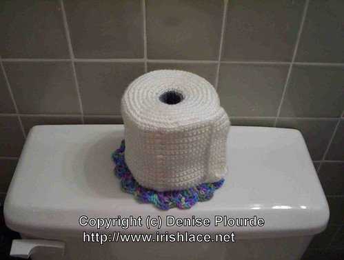 A toilet paper roll cover that looks like, well, a roll of toilet paper