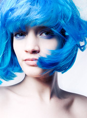 Smurfette (delinion) Tags: portrait selfportrait blues windy whitebackground messyhair smirk bangs bluehair paleskin blowinghair overtheexcellence