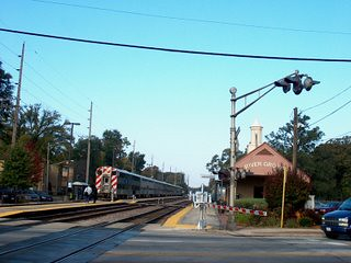Eastbound Metra commuter local stopping at the River Grove commuter rail station. River Grove Illinois. October 2006.