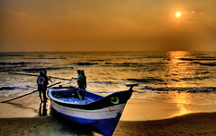 Sustainability - Morning as come (Sutheshnathan) Tags: morning sea india reflection beach beauty glitter sunrise work landscape boat fishing fisherman sand colours fishermen environment d300 platinumphoto sutheshnathan sustainabilitytheenvironment stby77