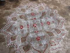 Swirls red and white kolam (melissaenderle) Tags: festival celebration symmetrical southindia kolam rangoli indianart radialsymmetry