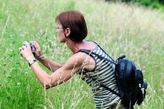 Uschi in the Meadow ... (Batikart) Tags: travel portrait people grass canon countryside flora leute stuttgart action outdoor meadow wiese portrt wildflower 2008 uschi aktion mensch swabian hohenheim wildblume canonpowershota610 viewonblack batikart 201108