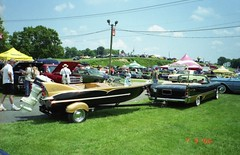 1957 DeSoto Adventurer convertible and matching custom boat (splattergraphics) Tags: convertible 1957 mopar carlisle motorboat desoto carshow fins outboard adventurer forwardlook defins customboat deboato carlisleallchryslernationals 1957deboato